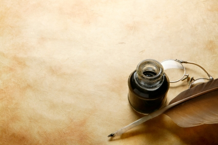 Quill-pen-parchment-and-ink-bottle