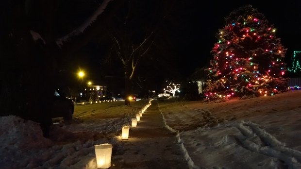 Candles line the sidewalks