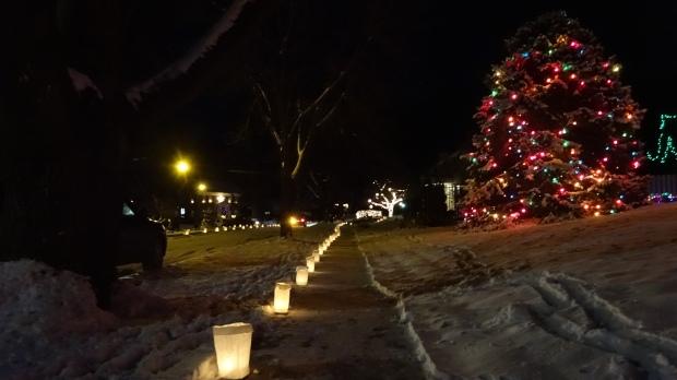 Candles line the sidewalks